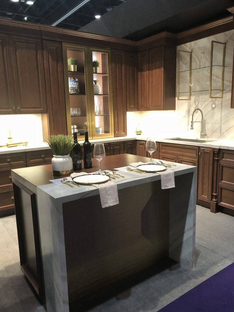 gn Fabuwood Warm Wood Cabinets Marble Backsplash Brass Gold Accents